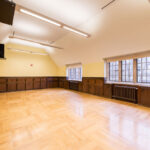An empty rehearsal hall for dancing and other activites.