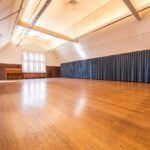 An empty dance hall with wooden floors