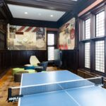 A shot of the North Landing of the Bistro Game Room showing the Table Tennis Area and Penn Themed Mural Decals