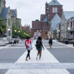 Students walking down Penn Commons on their way to student activities