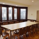A Shot of the small conference room table that seats 10 in room one-eleven, Showing the old world style windows to the Penn Commons area